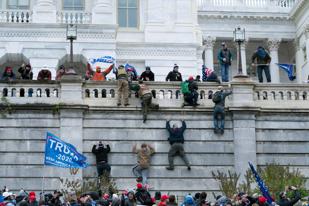 Right-wing extremists climbing the Capitol Building wall